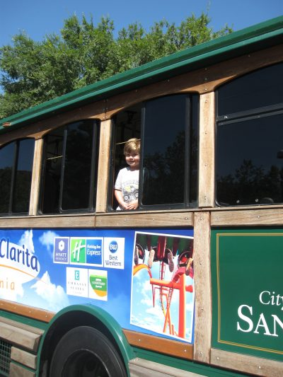 A boy gazes from ths window of the City of Santa Clarita trolley, which was available for youngsters to explore at this year's Touch-A-Truck event.